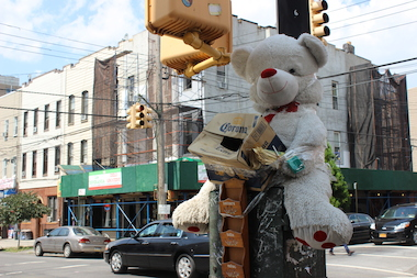 A white teddy bear taped to a pole at Wyckoff Avenue and Harman Street is attracting a lot of attention from locals.