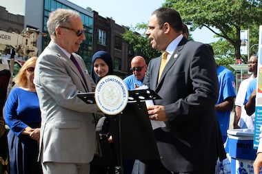 The Doe Fund founder George McDonald (left) with City Councilman Costa Constantinides (right) announcing an expansion of the nonprofit's street cleaning program in Astoria on Aug. 7, 2014.