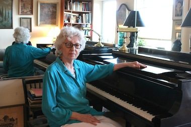 Doris Kaufman, 79, sits at her piano inside her apartment at 257 Clinton St. She has been asked to move from her one-bedroom apartment into a studio by HPD.