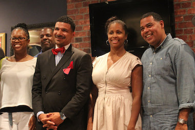 Dr. Steven Perry (wearing bowtie), founder of Captial Prep Harlem Charter School, met with local parents and community leaders Wednesday evening in Harlem to talk about a college prep high school he applied to open.