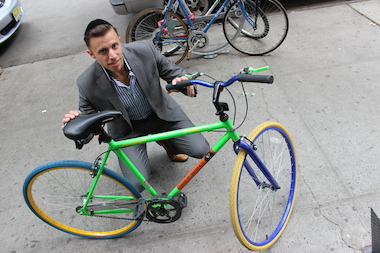 Joe Wasser, 30, has been giving out this colorful fixed-gear bike to new tenants who rent through his company, J Wasser & Co.