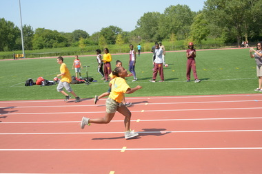 Runners celebrated the opening of the new track and field at Soundview Park on Tuesday.