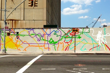 Colorful lines on the mural represent the routes of people who work behind the Navy Yard walls.