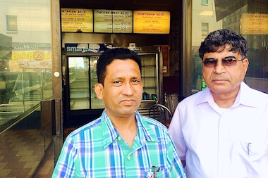 Business partners Shakil Ahmed (left) and Mohammad Hossain stand in front of their emptied restaurant Taste of Tandoor. The eatery was forced to close, after the landlord sold the Chambers Street building to a developer who will construct luxury condos.