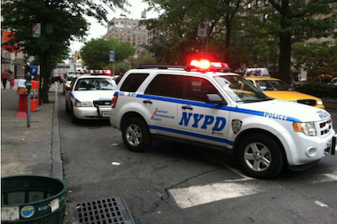 A police car at the scene of a crash in which a 75-year-old pedestrian was killed by a hit-and-run driver near Columbia University in September 2012. Seniors are more likely to be fatally struck by vehicles, a new study found.