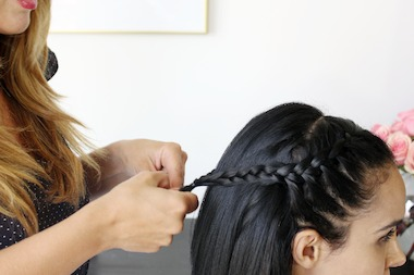 Hair stylist Gina Guercia braids the hair of Jen Ramos, an Upper East Sider who runs the lifestyle and art blog Made by Girl.