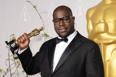 "Director Steve McQueen, winner of Best Picture for ""12 Years a Slave,"" poses after receiving the award."