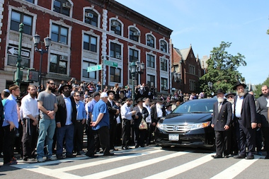 Friends of Yosef Raksin following his funeral procession past the Chabad-Lubavitch headquarters on Eastern Parkway in Crown Heights Monday morning.