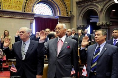 Longtime Assemblyman Denny Farrell (center) as he is sworn in for the Assembly's 234th session in January 2011. Farrell will face a primary challenger for the 71st District seat.