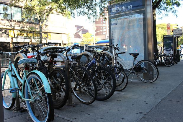 Many commuters leave their bikes near the Forest Hills subway station.