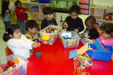 Students play with brightly colored toys during class at the Child Development Support Corporation in Clinton Hill.