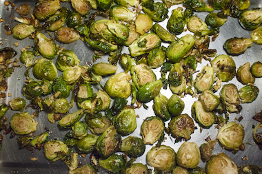 The Brussels sprouts are roasted with garlic and then paired with blue cheese and toasted pecans.