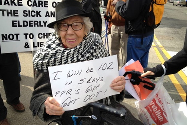 A 102-year-old resident of Prospect Park Residence at a 2014 rally protesting the abrupt closure of the assisted living facility.