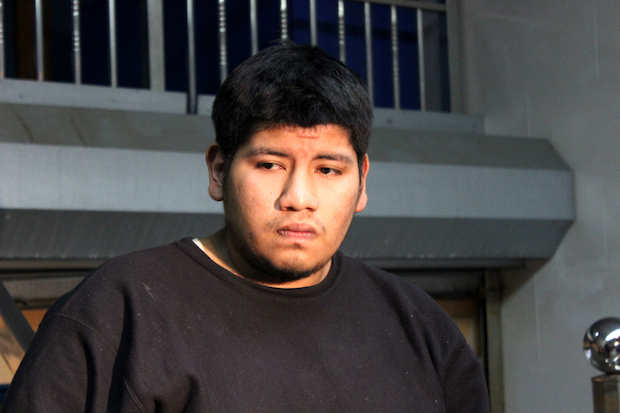Jonathan Daza, 22, spoke to reporters Wednesday night in front of his Sunset Park home. Daza was kicked in the back by a police officer on Sunday during a street fair. The officer was later suspended for the act, the NYPD said.
