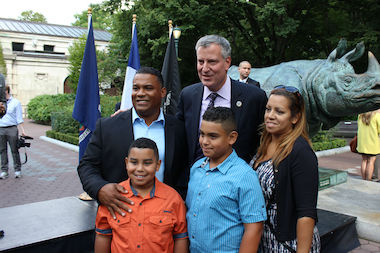 Mayor Bill de Blasio with Jose and Mildred DeLeon and their sons Alexander and Daniel at the Bronx Zoo Thursday, Sept. 18, 2014. The family says a trip to the Bronx Zoo can cost $100 and they plan to sign up for the Municipal ID plan, which provides free yearlong memberships at 33 of the city's cultural institutions.