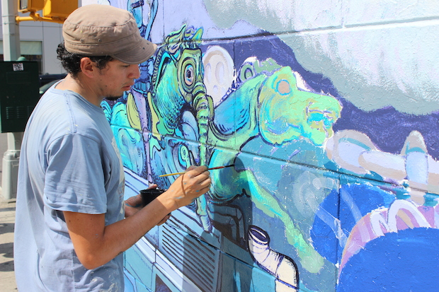 A mural against police violence is going up in Mott Haven.