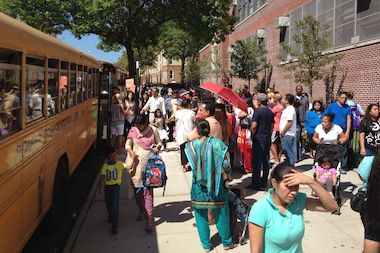 Parents pick up their kindergarteners at P.S. 11 on the first day of school Thursday afternoon. The kindergarten students are being bused to P.S. 171 for class this year as a new addition is being built at P.S. 11.