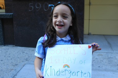 Sophie Sherinsky, 4, shows off the sign she made for her first day of kindergarten in September 2014. She lives in Union Square, just a few blocks away from her new school.