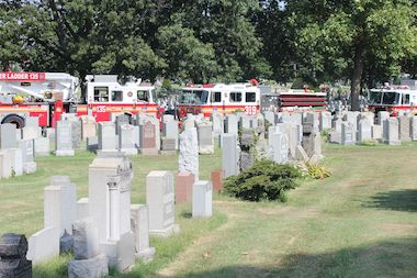 The man was critically injured and trapped in a grave in St. John Cemetery, the FDNY said.