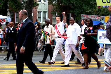 Gov. Andrew Cuomo, center, waves to parade-watchers during the 47th annual West Indian-American Day Parade on Sept. 1, 2014. The governor and his running mate for lietenant governor, former Rep. Kathy Hochul, are facing a challenge from Zephyr Teachout and Tim Wu.