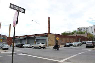 A 209-unit, seven-story building will replace this fomer commercial laundry facility in Crown Heights, according to filed permits.