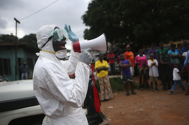 Aid workers stage an Ebola awareness event on October 15, 2014 in Monrovia, Liberia. The group performs street dramas throughout Monrovia to educate the public on Ebola symptoms and the handling of people who are infected with the virus, which has killed more than 4,400 people in Western Africa.