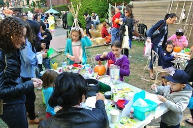 Children decorate pumpkins at the 2013 Harvest Festival.