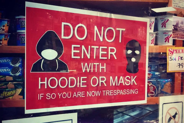 "The sign says ""Do not enter with hoodie or mask. If so you are now trespassing."""