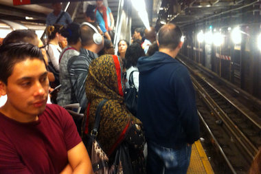 Overcrowding on a subway platform at the Roosevelt Avenue station.