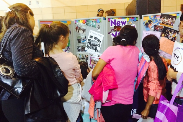Families looking to learn more about Park Slope's New Voices middle school check out its booth at a previous middle school fair for District 15.