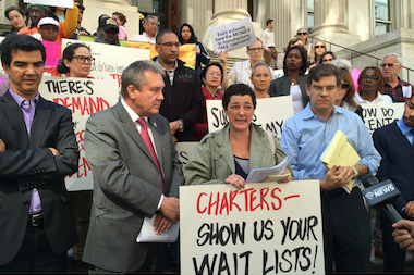 Public school parents and city officials gathered in front of Tweed Courthouse on Oct. 8, 2014. They said data shows that two-thirds of Success Academy charter schools are under-enrolled.