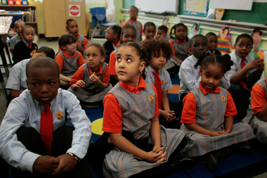 Students (L to R, front row) Lamine Cisse, Marjery Pacheco, and Mia McNair sit quietly and wait for their teacher at Harlem Success Academy, a free, public elementary charter school on March 30, 2009 in District 3.