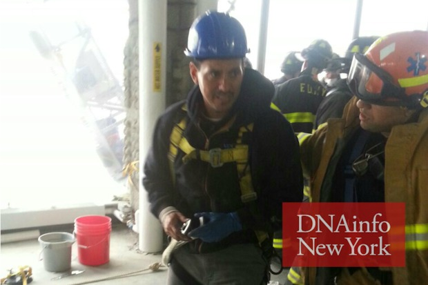 Firefighters worked to   free two window washers stuck on a scaffold at the 68th floor of One World Trade Center.