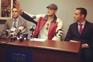 Jorge Pena, center, wearing his 8-ball jacket, with his lawyers, Cary London and Joseph Indusi of London Indusi LLP at a press conference on Nov. 13.