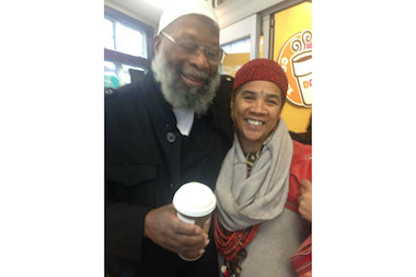 Sekou Odinga gets some coffee with his wife Tuesday morning after being released from prison.