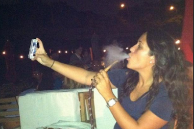 A woman smokes a hookah at La Marina. Between May and August 2014, the venue made more than $160,000 in hookah sales.