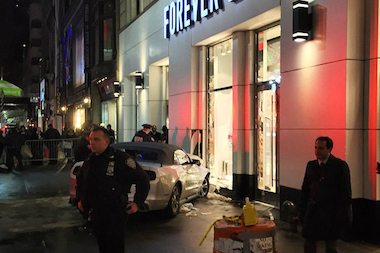A driver hit two other vehicles before hopping a curb and slamming into a clothing store, police said.
