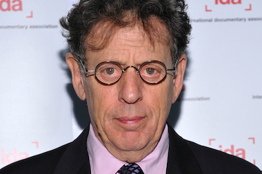 Composer Philip Glass donated a page from an original music score, which will be sold for $8,000 to benefit NYU Faculty Against the Sexton Plan.
