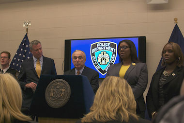 Police Commissioner Bill Bratton and other officials announce the NYPD's body camera pilot program at the Police Academy on Dec. 3, 2014.