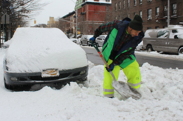 New Yorkers shoveled their way through a smaller amount of snow than had been predicted, Jan. 27, 2015.