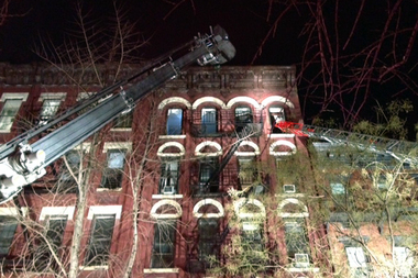 A fire ripped through the space between the top floor ceiling and the roof at 412 W. 46th St. Wednesday evening, Feb. 4, 2015.