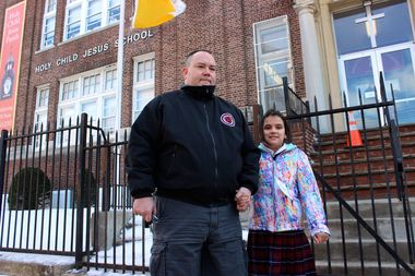 Brianna Grady with her father Brian in front of Holy Child Jesus Catholic Academy on 86th Avenue in Richmond Hill. Brianna was one of 21 students taken to a local hospital after a mishap during a science experiment.