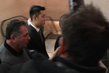Officer Peter Liang enters Brooklyn Supreme Court on Feb. 11, 2015 to be arraigned for shooting Akai Gurley to death.