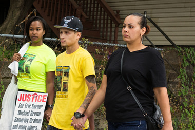 Ramsey Orta (center), who shot the cellphone video of Eric Garner's arrest and death, sued the city for $10 million claiming he was targeted for