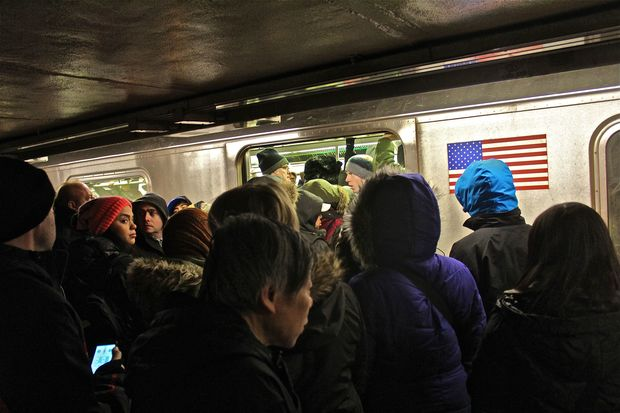 Crowds packed subway platforms and trains in Union Square as cold weather wreaked havoc on a Monday morning commute.