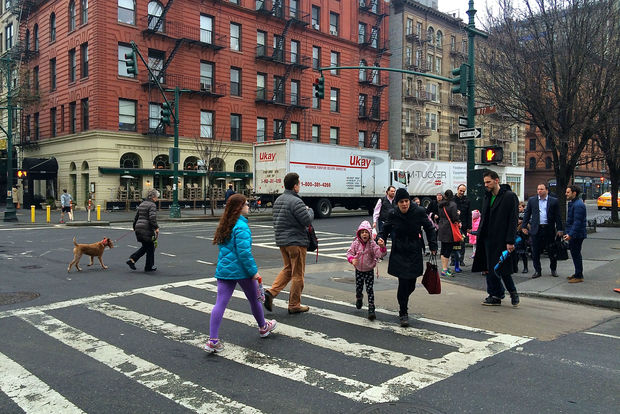 The corner of West 77th Street and Columbus is too busy and needs a crossing guard and additional safety features to make it safer, parents of kids who go to school next door argued.