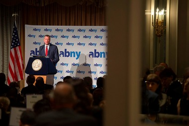 Mayor Bill de Blasio announced plans to invest $150 million in Hunts Point Market in The Bronx over the next 12 years and also called on business leaders to raise their minimum wage above $13 at an Association for a Better New York breakfast.