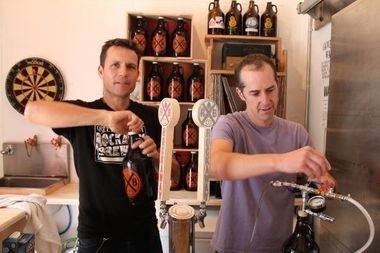 Marcus Burnett (left) and his business partner, Ethan Long of Rockaway Brewing Company at their growler room.