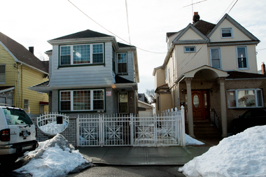 The house on the left, on 95th Avenue in South Richmond Hill, had 43 complaints made against it in 2014. The status of the complaints were not clear and attempts to reach the owners were unsuccessful.