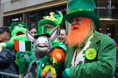 Dennis O'Mann from Southfield, Rhode Island, left, and Bill Dexter from Georgetown, Conn., right, dress up in green and hold puppets along the Fifth Avenue parade route of the 2015 St. Patrick's Day Parade.